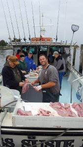 first-mate-steve-filleting-fish-on-the-charter