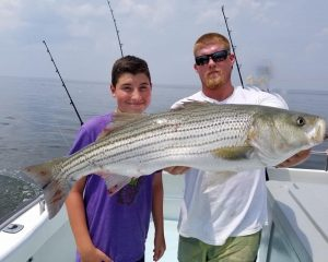 first-mate-austin-and-a-happy-angler-fishing-chesapeake-bay