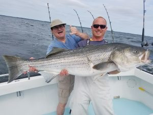 fishing-charter-first-mate-with-a-huge-catch-from-chesapeake-bay