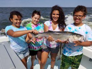 Kids catching Chesapeake Bay Rockfish Striped Bass 2021 fishing season